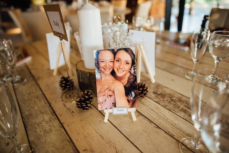 Personalised wedding table decorations with pinecones at woodland reception