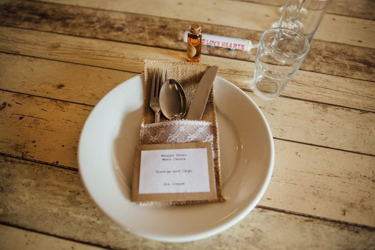 Simplistic table settings at woodland day in autumn with personalised love hearts