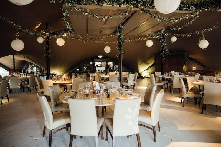 Woodland styled decor at relaxed celebration in autumn with hanging paper lanterns