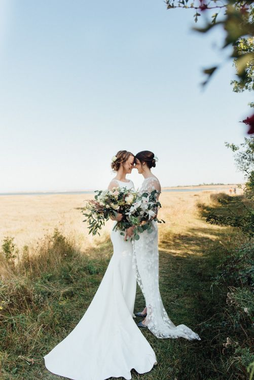 Outdoor autumn dreamy day with two bouquets in secluded woodland setting