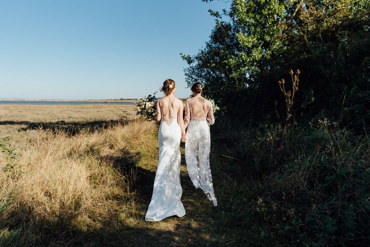 Two brides celebrating same sex reception in a  beautiful woodland setting