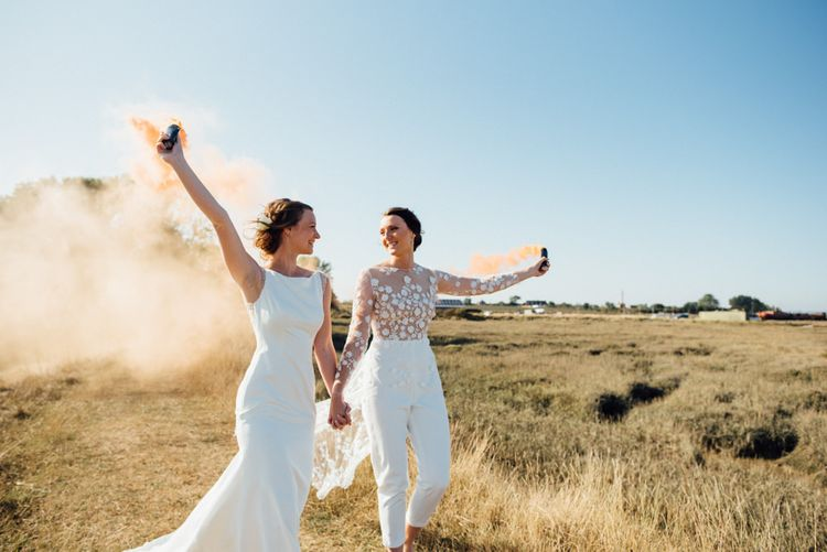 Outdoor celebrations in a field with smoke bombs