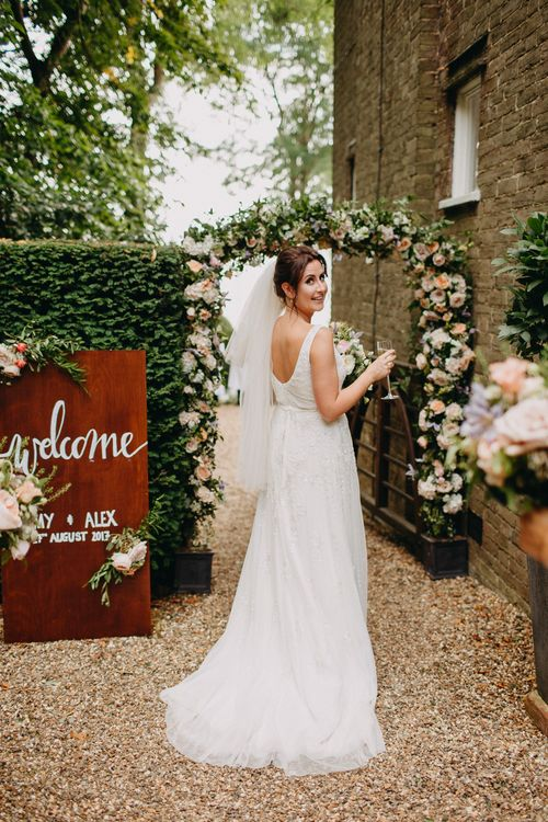 Floral Arch from Topiary Tree | Church Wedding Ceremony | Bride in Karen Willis Holmes | Groom in Custom Made Suit by Suit Supply | Summer Wedding at Family Home in Kent | Glass Marquee from Academy Marquees | Frances Sales Photography