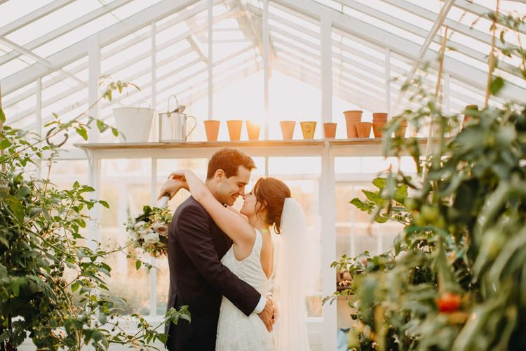 Golden Dusk Couple Shots | Church Wedding Ceremony | Bride in Karen Willis Holmes | Groom in Custom Made Suit by Suit Supply | Summer Wedding at Family Home in Kent | Glass Marquee from Academy Marquees | Frances Sales Photography