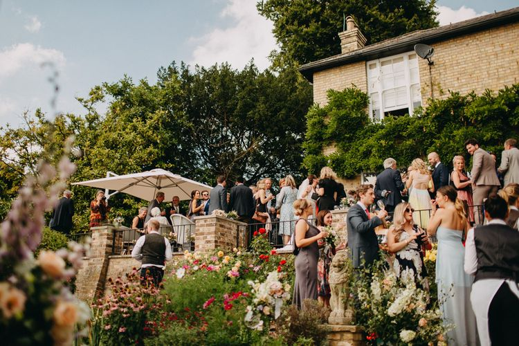 Outdoor Wedding Reception | Bride in Karen Willis Holmes | Groom in Custom Made Suit by Suit Supply | Summer Wedding at Family Home in Kent | Glass Marquee from Academy Marquees | Frances Sales Photography