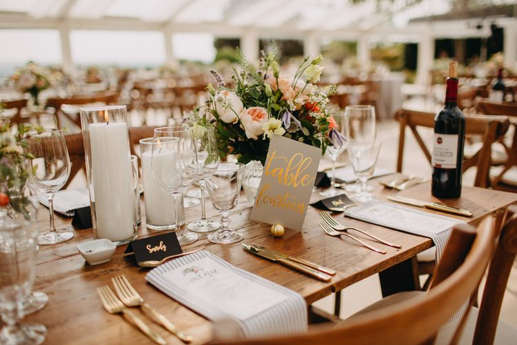 Gold lettered table Names | Hand Stitched Linen Napkins | Bride in Karen Willis Holmes | Groom in Custom Made Suit by Suit Supply | Summer Wedding at Family Home in Kent | Glass Marquee from Academy Marquees | Frances Sales Photography