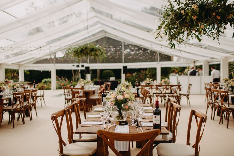 Rustic Tables | Soft gold Finishes | Hand Stitched Linen Napkins | Bride in Karen Willis Holmes | Groom in Custom Made Suit by Suit Supply | Summer Wedding at Family Home in Kent | Glass Marquee from Academy Marquees | Frances Sales Photography