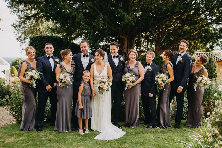 Group Shot | Flowers from Topiary Tree | Bride in Karen Willis Holmes | Groom in Custom Made Suit by Suit Supply | Summer Wedding at Family Home in Kent | Glass Marquee from Academy Marquees | Frances Sales Photography