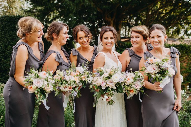 Bride and Bridesmaids | Flowers from Topiary Tree | Bride in Karen Willis Holmes | Groom in Custom Made Suit by Suit Supply | Summer Wedding at Family Home in Kent | Glass Marquee from Academy Marquees | Frances Sales Photography