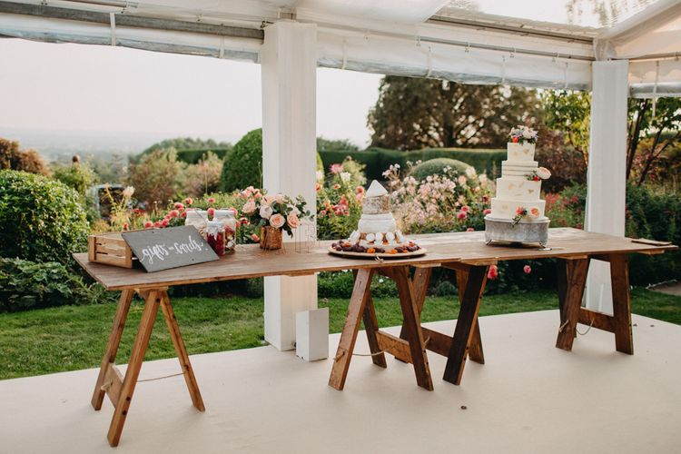 Cake Table | Flowers from Topiary Tree | Bride in Karen Willis Holmes | Groom in Custom Made Suit by Suit Supply | Summer Wedding at Family Home in Kent | Glass Marquee from Academy Marquees | Frances Sales Photography