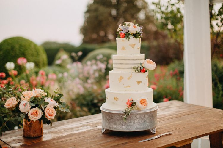Cake Table | Smooth ButtercreamCake | Flowers from Topiary Tree | Bride in Karen Willis Holmes | Groom in Custom Made Suit by Suit Supply | Summer Wedding at Family Home in Kent | Glass Marquee from Academy Marquees | Frances Sales Photography