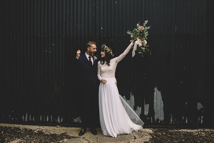 Happy Bride in Long Sleeve Lace  Wear Your Love Wedding Dress and Flower Crown and Groom in  Navy Moss Bros. Suit