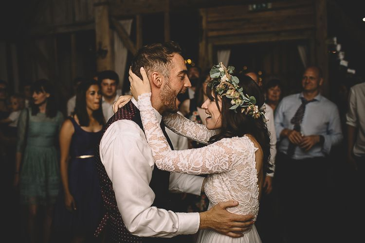 Bride in Long Sleeve Lace Wear Your Love Wedding Dress and Flower Crown and Groom  in Navy Moss Bros.  Suit Singing to Each Other During First Dance