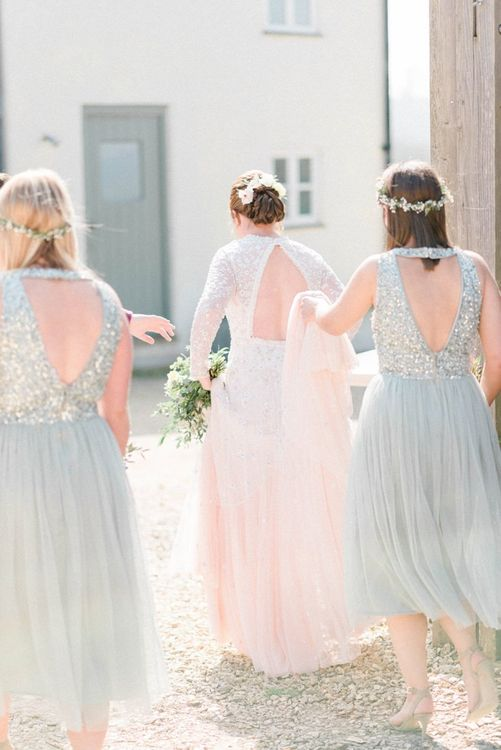 Bridesmaids in Sequin and Tulle Dresses Holding the Brides Train
