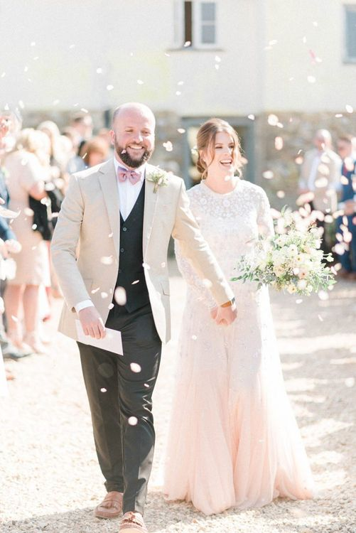 Confetti Moment with Bride in Needle & Thread Ombre Wedding Dress and Groom in Beige Blazer and Pink Bow Tie