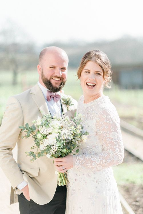 Bride in High Neck Needle & Thread Wedding Dress and Bearded Groom in Bow Tie Laughing