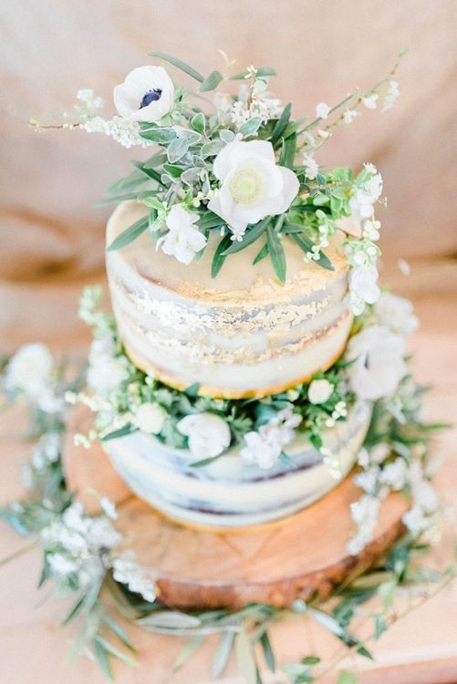 Semi Naked Wedding Cake Decorated with White and Green Flowers