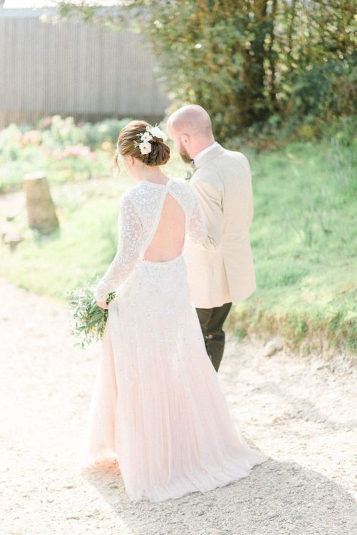 Bride in Needle & Thread Wedding Dress with Key Hole Back Detail