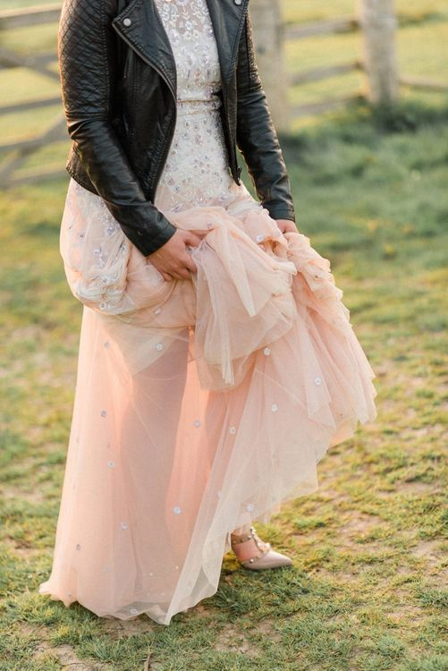Cool Bride in Pink Ombre Needle & Thread Wedding Dress with Valentino Rockstud Shoes and Leather Jacket Bridal Accessories