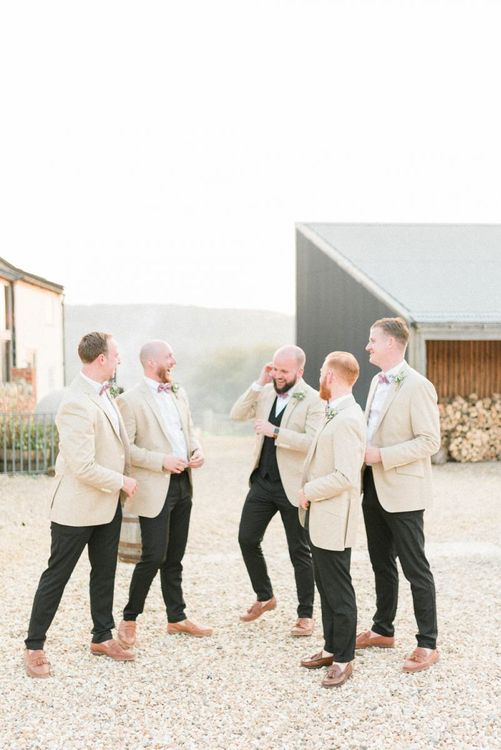 Groomsmen in Black Suits with Beige Jackets and Bow Ties