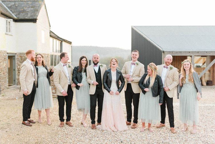 Wedding Party Portrait with Groomsmen in Beige Blazers and Bridesmaids in Leather Jackets
