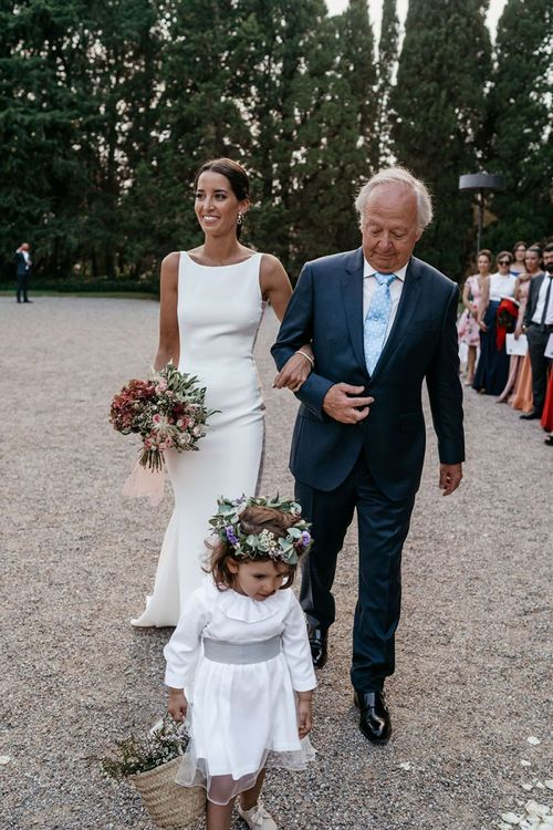 Brides walk down the aisle in  fitted wedding dresses with their Father's