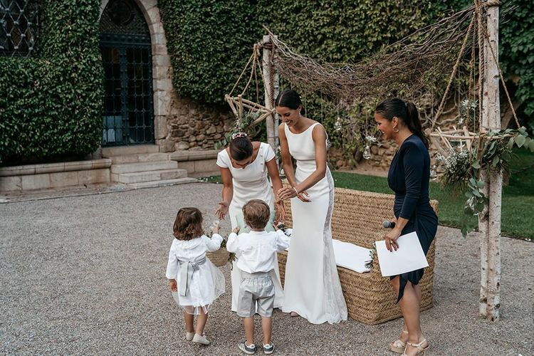Spanish wedding with brides in fitted wedding dresses