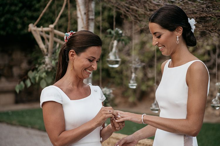 Brides exchange rings at destination wedding