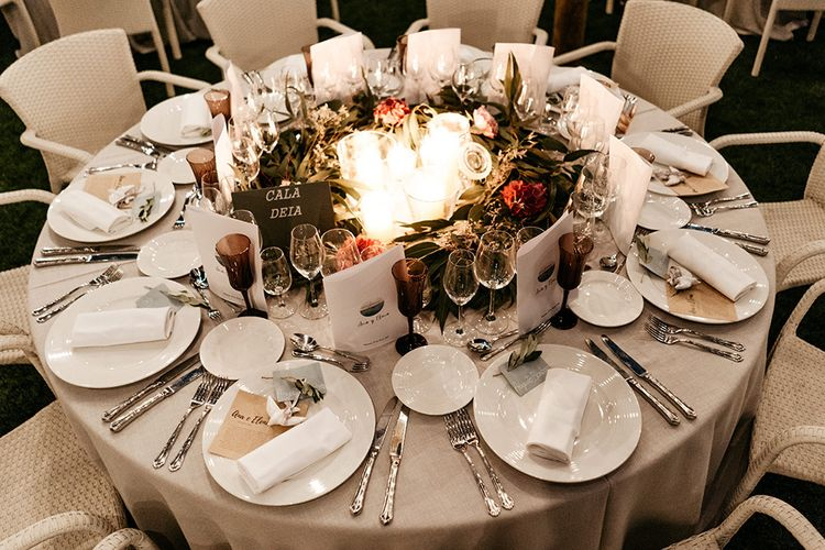 Stunning wedding table decor with flowers and candles