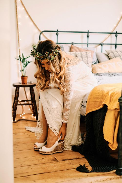 Bridal preparations and white wedges shoes