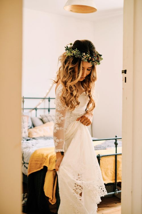 Bridal preparations for rustic wedding with globe guest book