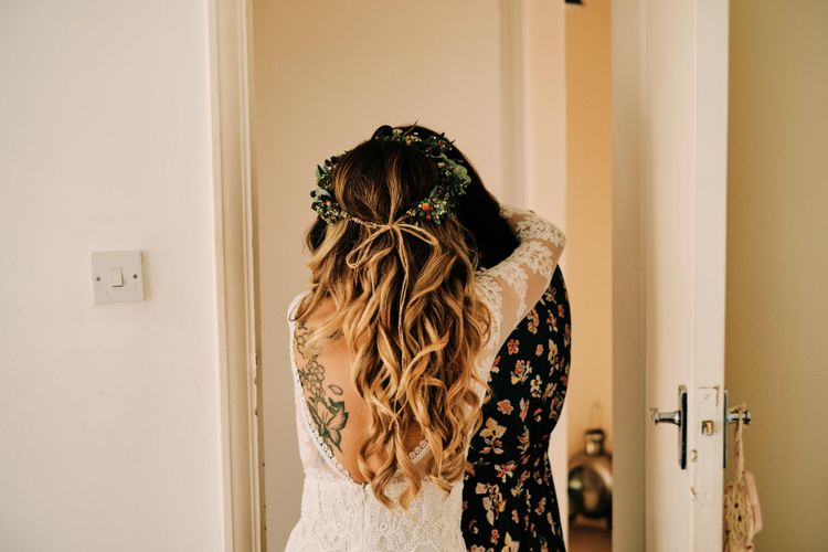 Bridal hair for rustic wedding with globe guest book