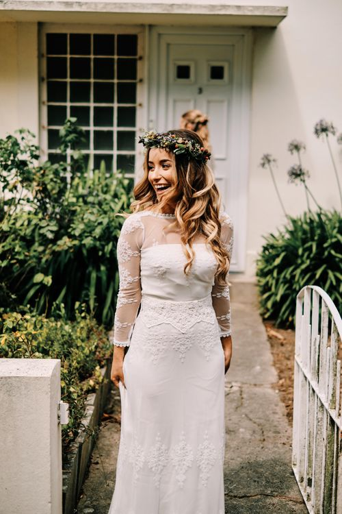 Bride in lace wedding dress with hair down