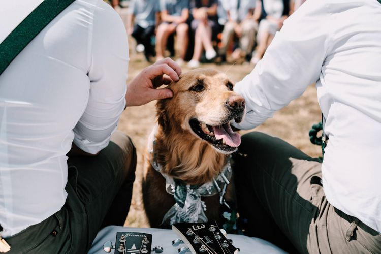 Pet dog attends rustic wedding with globe guest book