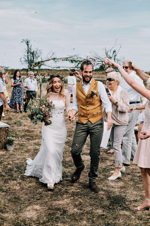 Confetti exit for bride and groom at rustic wedding