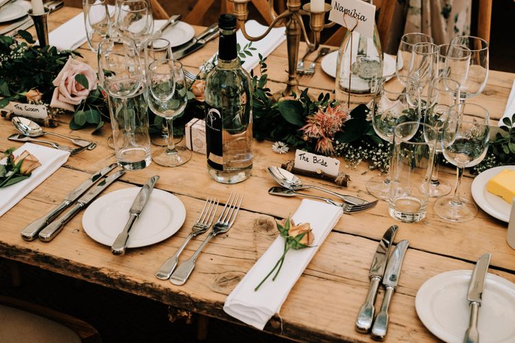 Wedding breakfast decor with foliage table runner