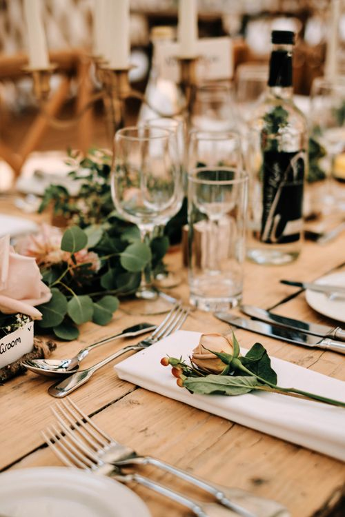 Wedding table decor with soft florals and foliage table runner