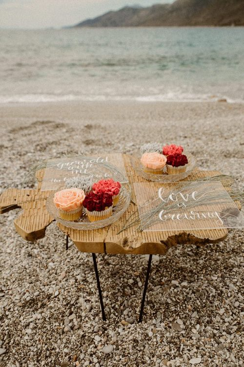 Beach Elopement wedding decor, signs and cakes
