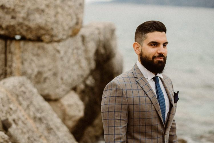 Bearded groom in beige and blue check suit