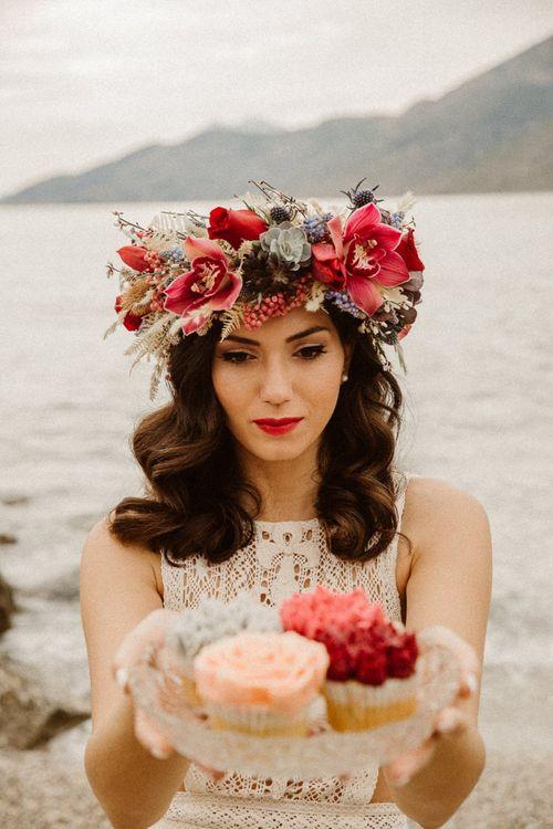 Boho bride in red flower crown at beach elopement