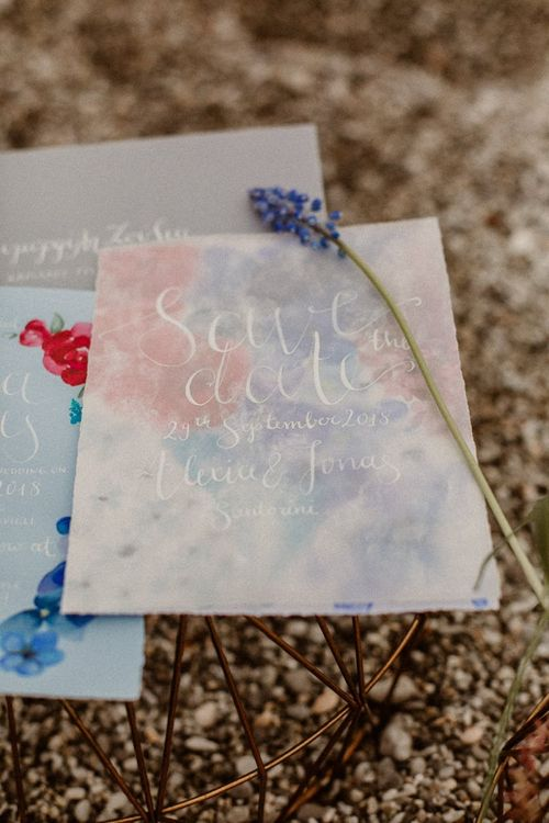 blue and red save the date wedding stationery