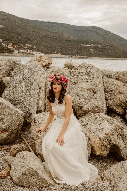 Boho bride in lace wedding dress and flower crown for beach elopement
