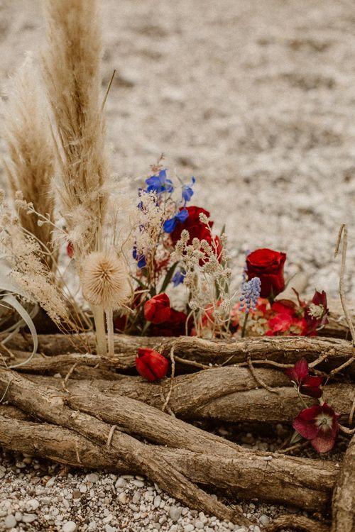 Natural wood, grasses and floral arrangement