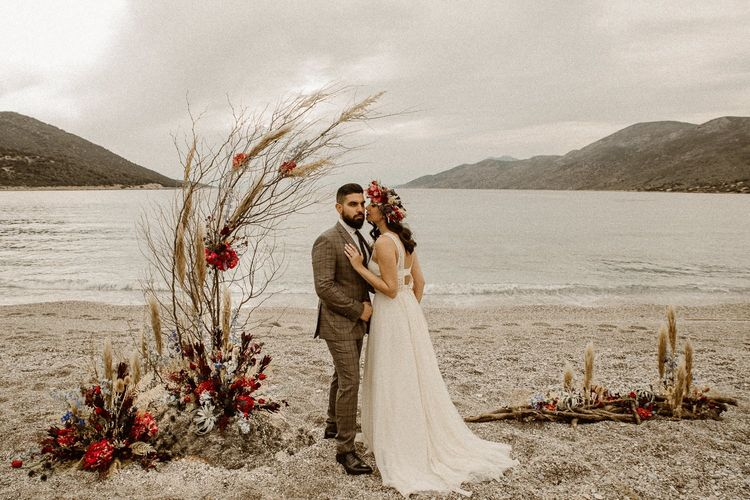 Boho bride and groom on the beach at intimate elopement