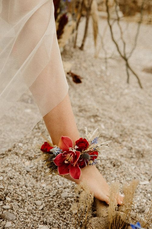 Red orchid ankle corsage for beach elopement