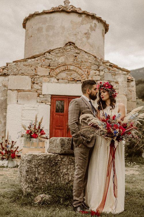 Boho bride and groom at ancient Greek Castle