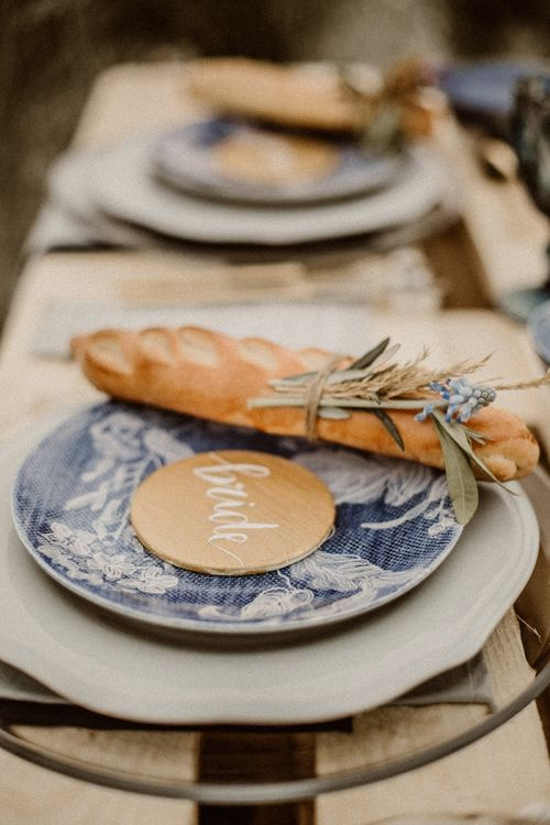 Place setting with blue tableware and bread