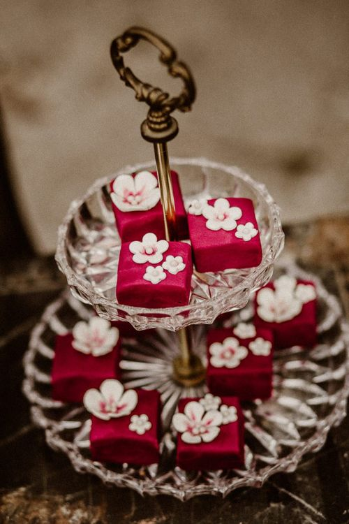 individual cakes on glass cake stand