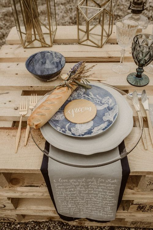 Place setting for beach elopement with fabric table runner