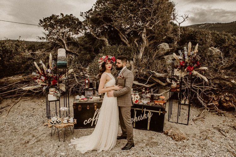 Boho bride and groom at coffee and whiskey stations for beach elopement